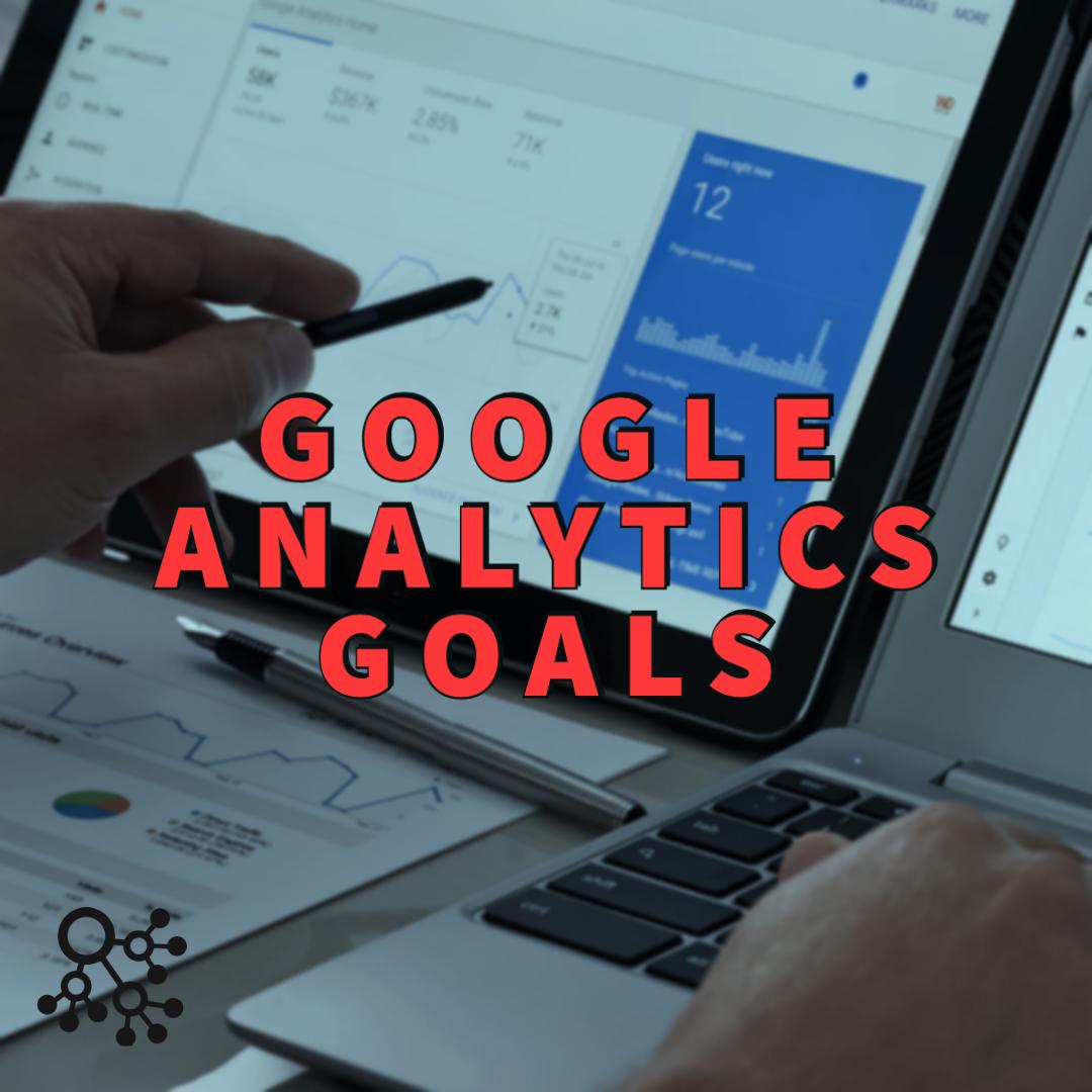 Google analytics goals written over computer with displayed graph